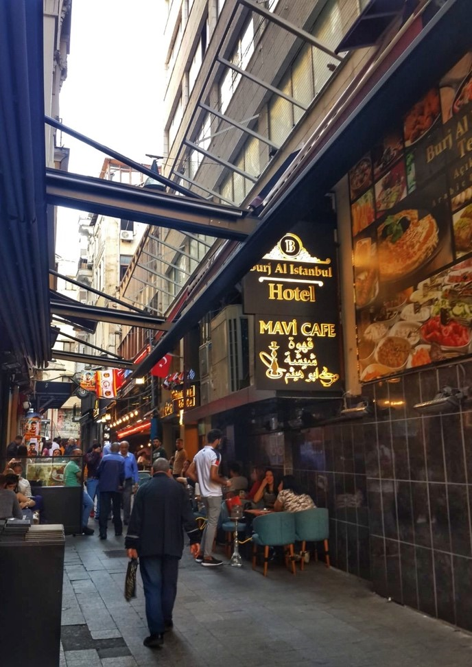 Side street of Istiklal Street with signs in Arabic